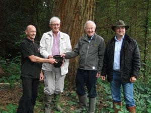 Presenting a redwood seedling to Shane Hollywood were Tony Carey of Crann, Lord Rosse and his son Patrick Parsons at Birr Castle Estate