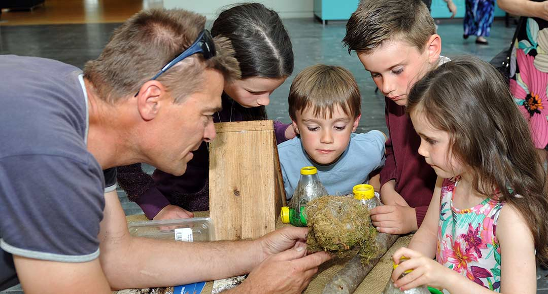 Dale Treadwell talking to schoolchildren about trees and nature