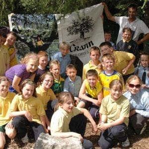 Children taking part in a school woodland project with Crann